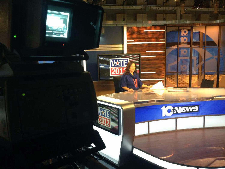 An achor is sitting in studio of WBNS (10TV News)