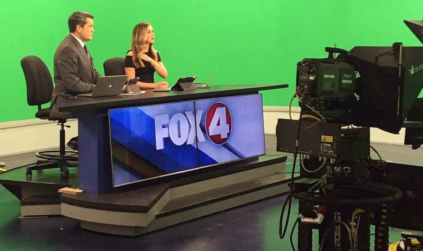 Fox 4 News anchors at studio