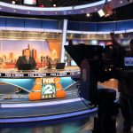 Newscasters briefing news updates