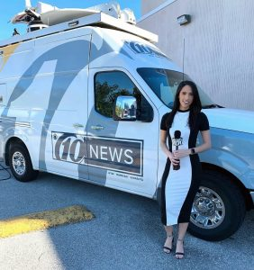 Lia Fernandez with 10 Tema Bay news van