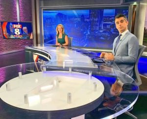 Elizabeth Noreika with another newscasters