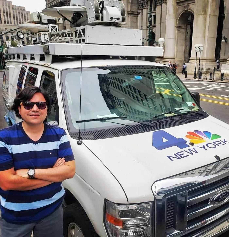 Roberto Muñoz Castro with news van