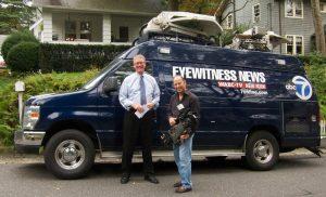 WABC TV reporter with channels' news van