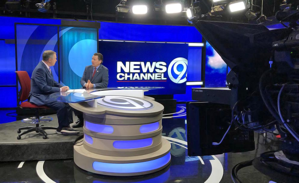 WSYR TV newscasters on camera