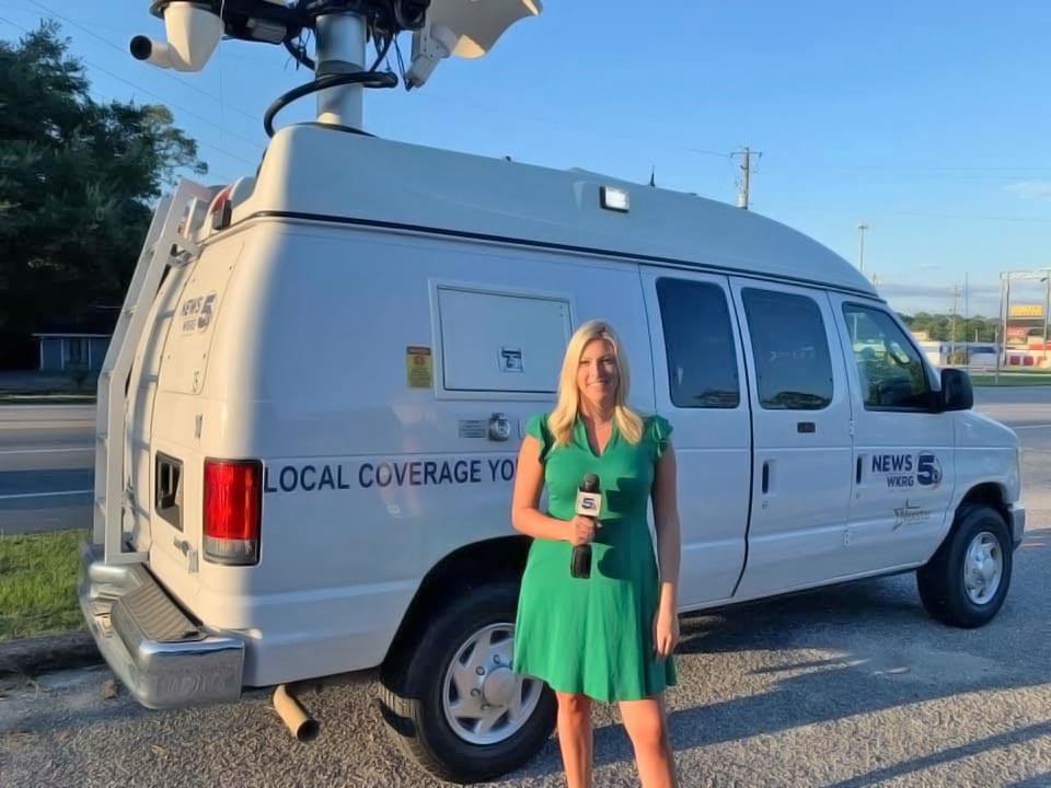 Meaghan Mackey with WKRG News Satellite van