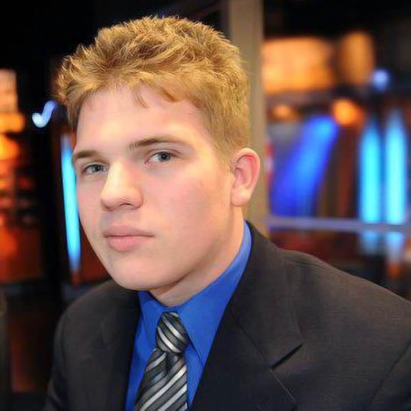 Nick Kelly presenting cast on KOAM News