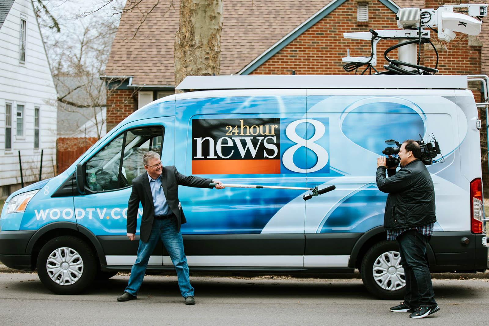 WOOD TV 8 Journalists with Satellite Van